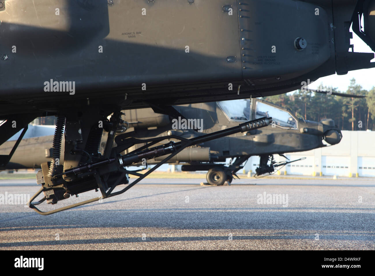 close up view of the m230 chain gun on an ah 64d apache helicopter