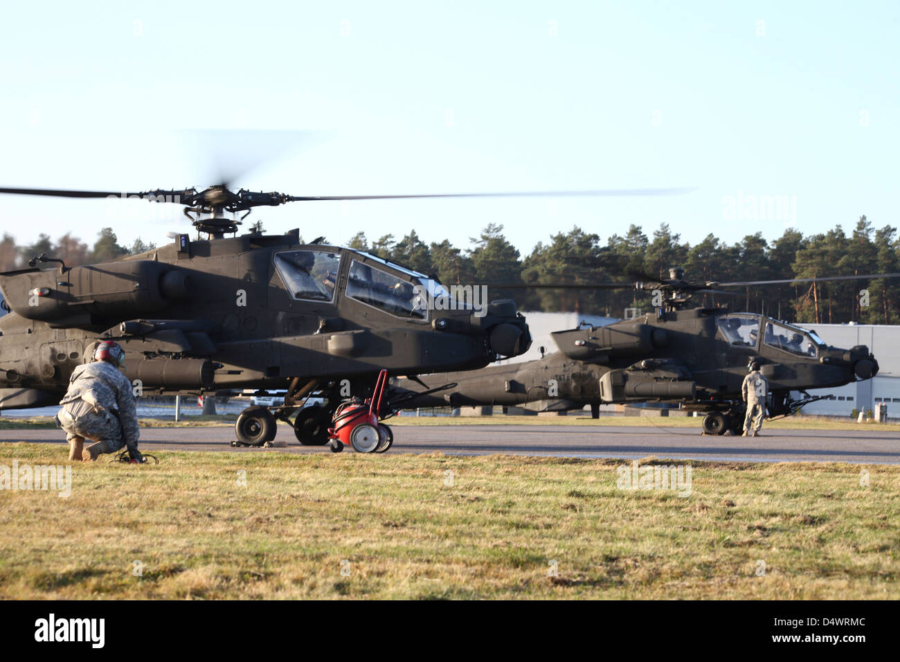 U.S. Army AH-64D Apache helicopters prepare for takeoff. Stock Photo