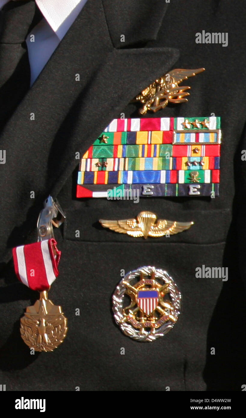 Close-up view of military decorations and honors on a commander's dress uniform. - Stock Image