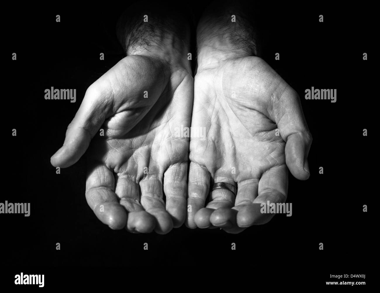 Holding out hands for help. - Stock Image