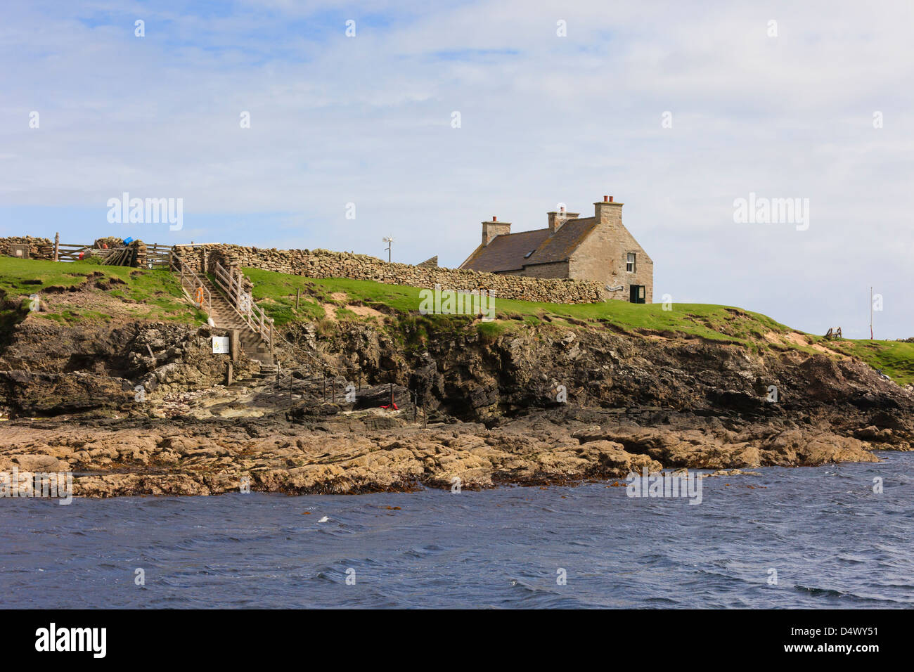 Offshore view of Visitors Centre and landing on Isle of Noss National Nature Reserve, Shetland Islands, Scotland, - Stock Image