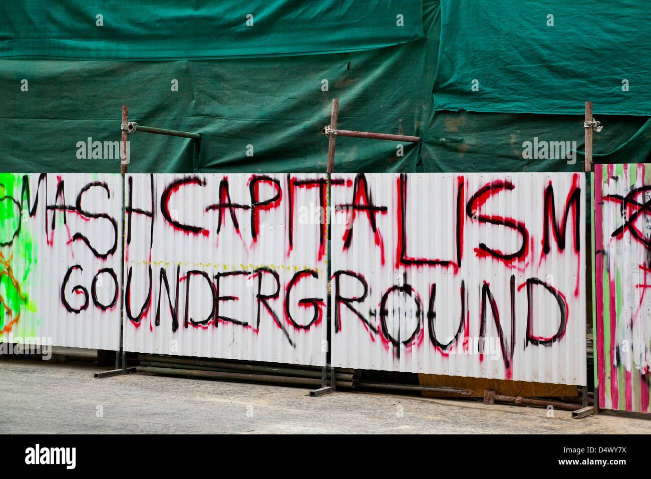 Anti-capitalist slogans and grafitti on hoardings, Nicosia, Cyprus - Stock Image