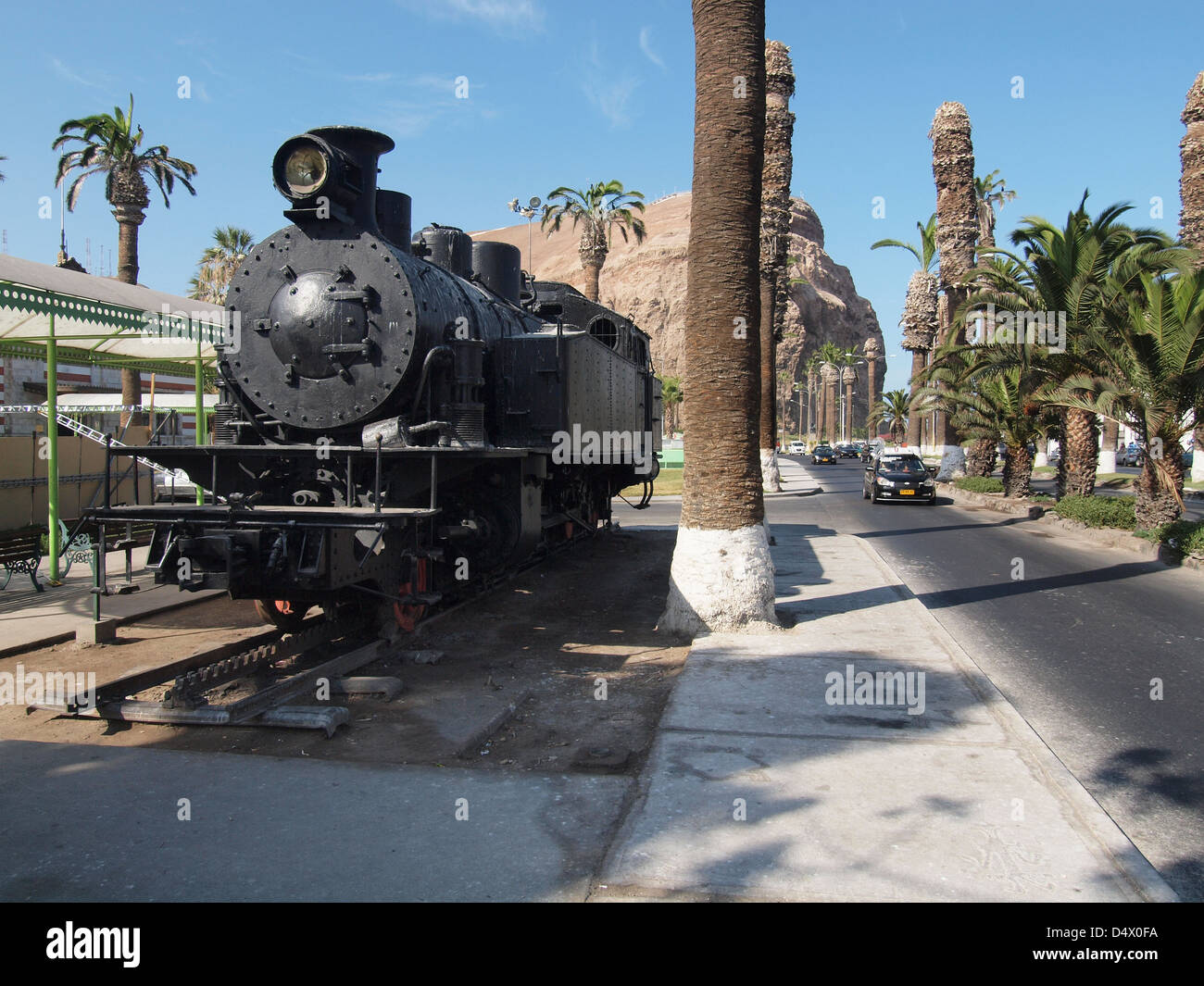 One of the original locomotives of the Arica to La Paz railway on display in the town centre of Arica Stock Photo