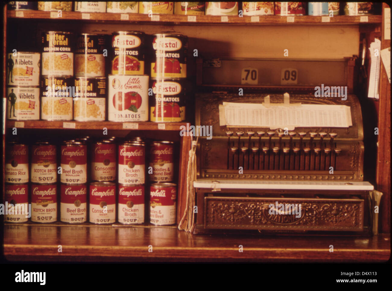 Old Style Cash Register and Canned Goods in a Butcher Shop in New Ulm, Minnesota ..., 10/1974 - Stock Image