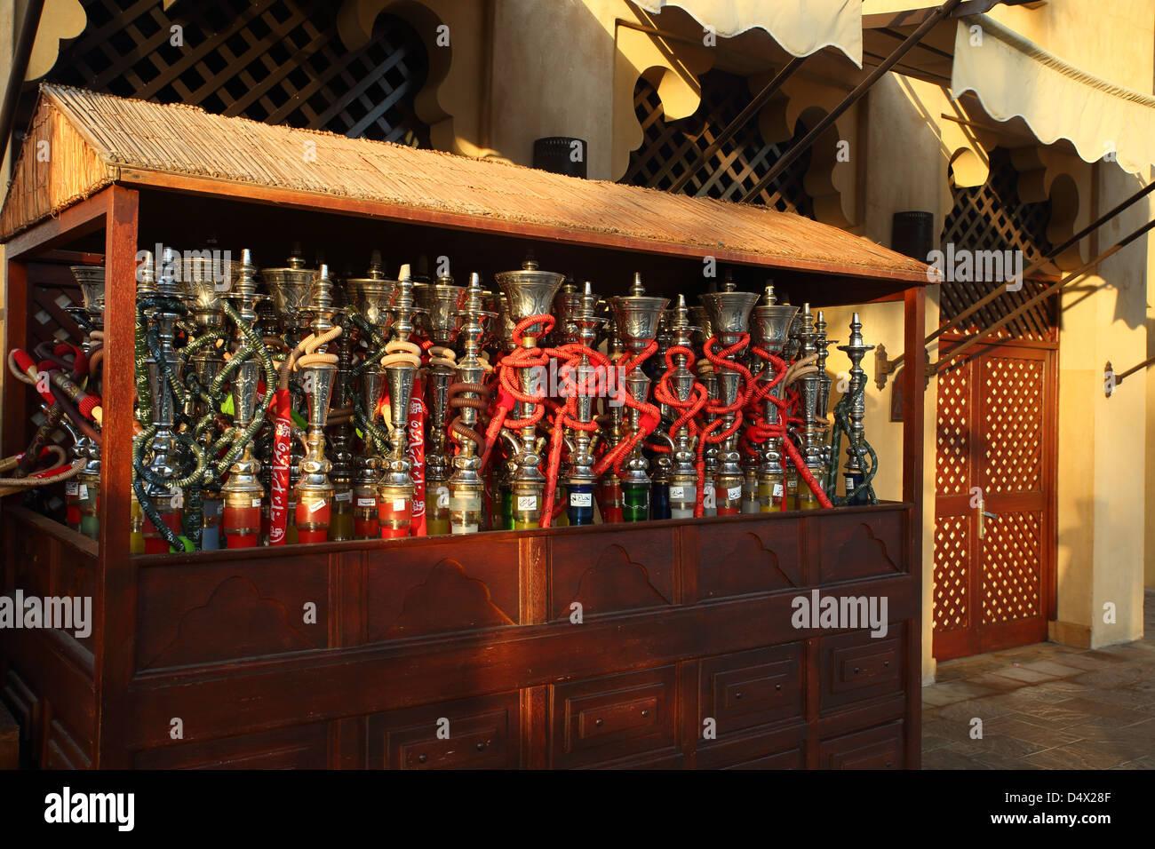 Shisha pipes on market stall at the Souk Madinat in Dubai, United Arab Emirates - Stock Image