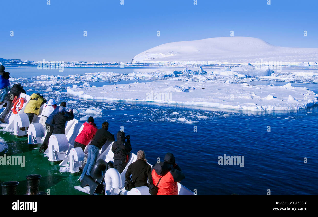 Tourists admiring the scenery near Antarctic Sound in Antarctica - Stock Image