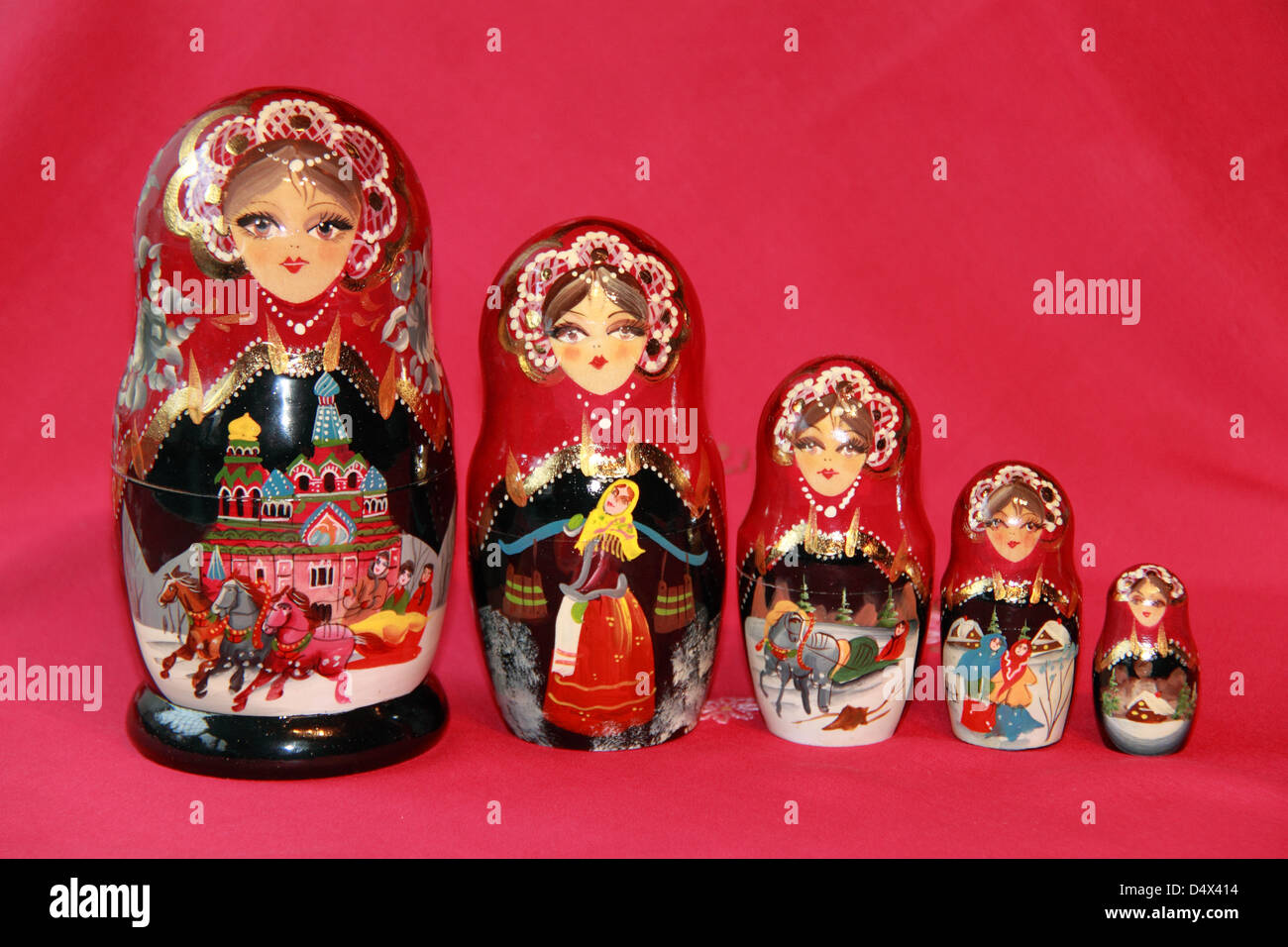 Matryoshka doll, or Russian nesting/nested painted wooden doll, in which increasingly smaller figures sit inside - Stock Image