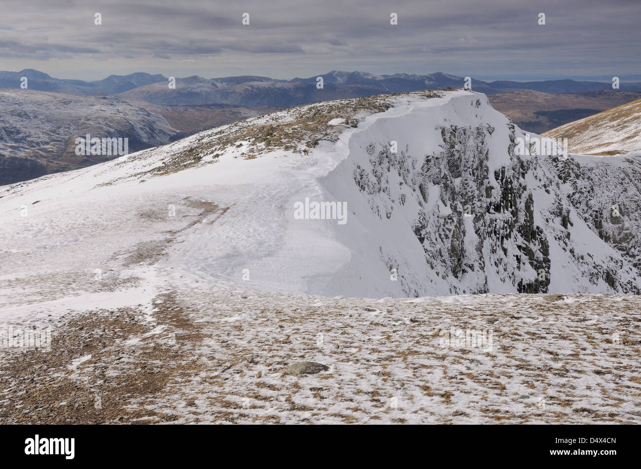 Snow clad Dollywaggon Pike in winter in the English lake District - Stock Image