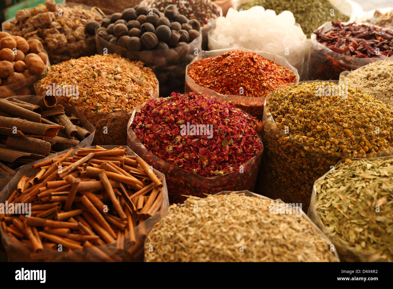 Bags of colorful spices at souk market in Dubai, United Arab Emirates - Stock Image