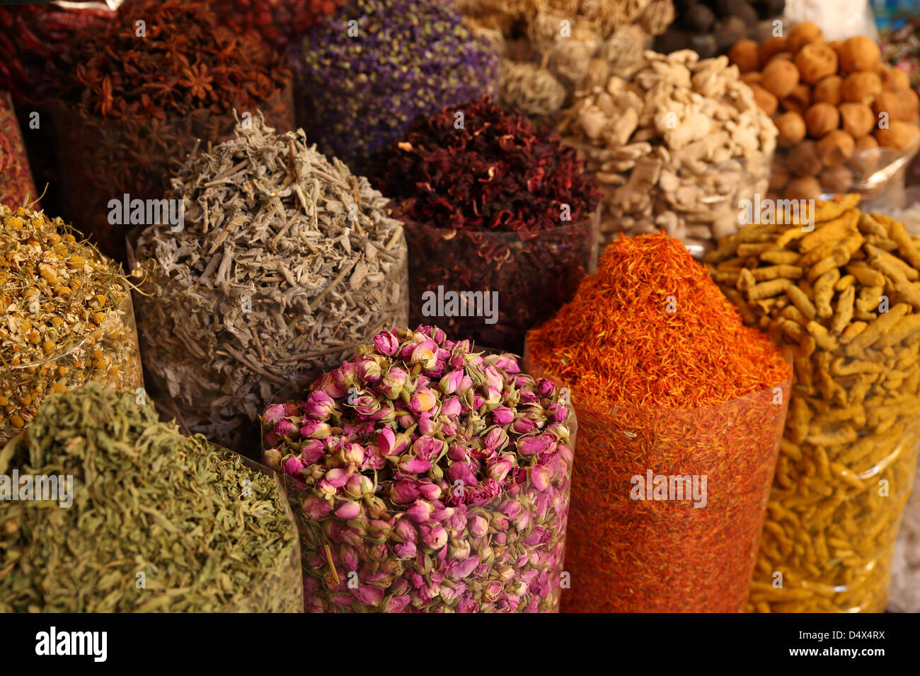 Bags of colorful spices at market in Dubai, United Arab Emirates - Stock Image