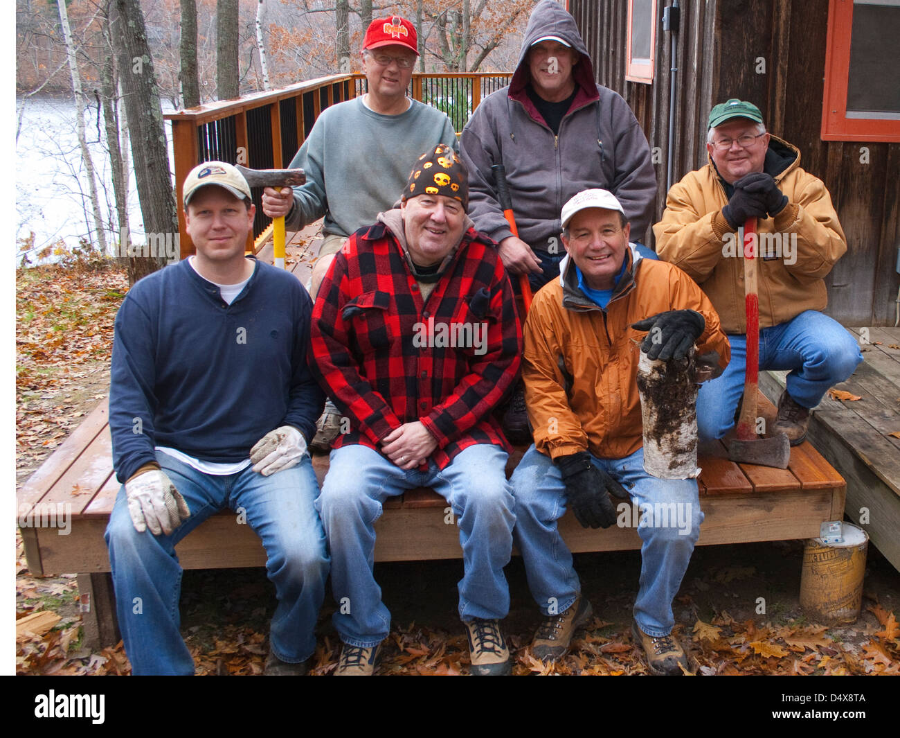 Group of men bonding on a men's wood cutting weekend. Cumberland Wisconsin WI USA - Stock Image