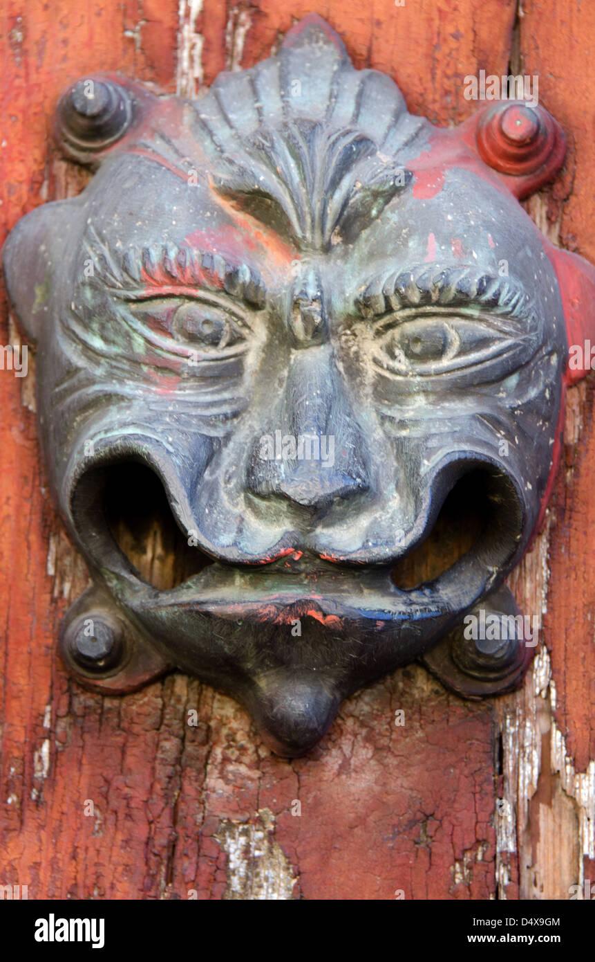 A Cast Iron Door Knocker In Oaxaca, Mexico Has Lost Its Clapper.