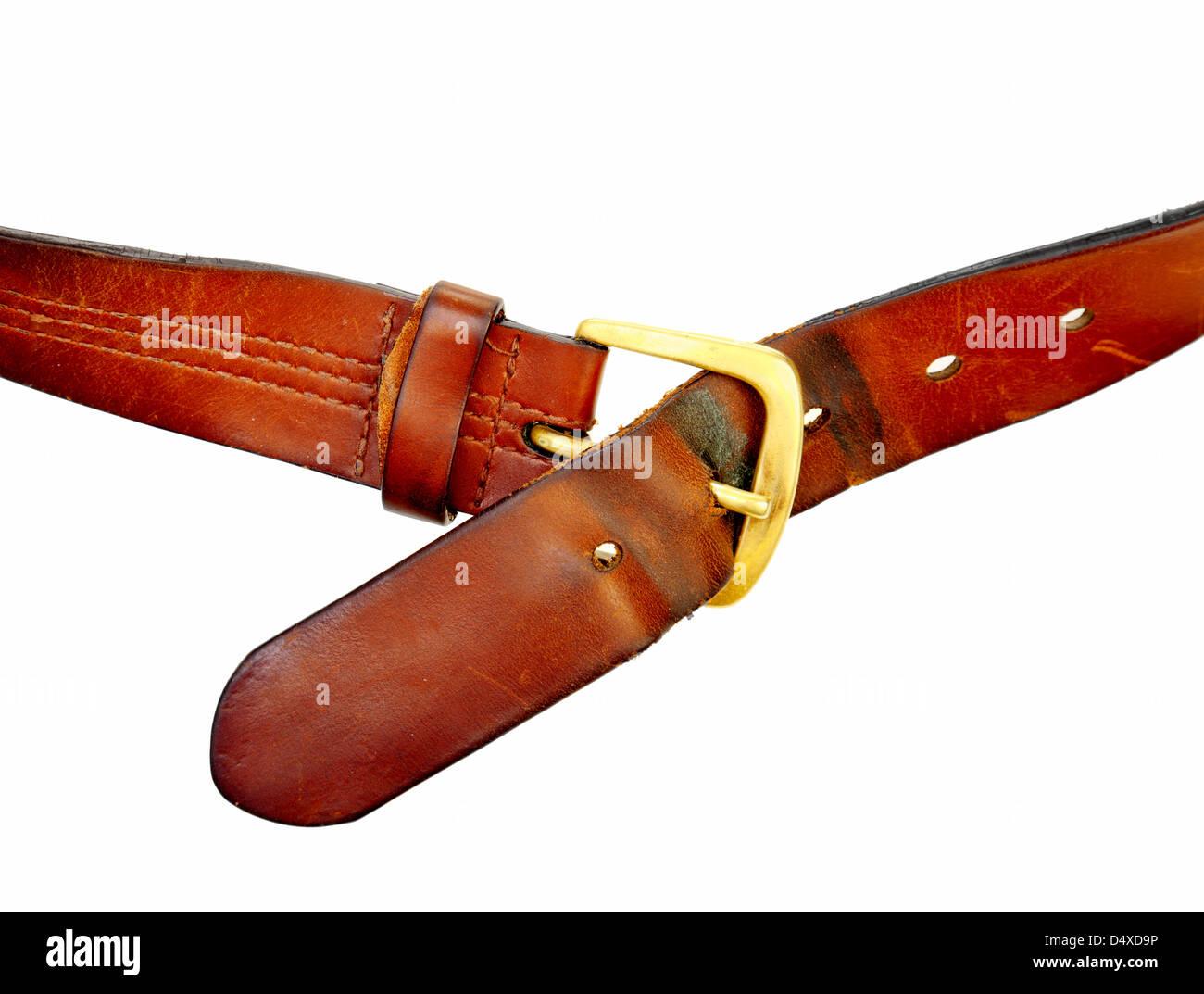 used broun leather belt, isolated on white background - Stock Image