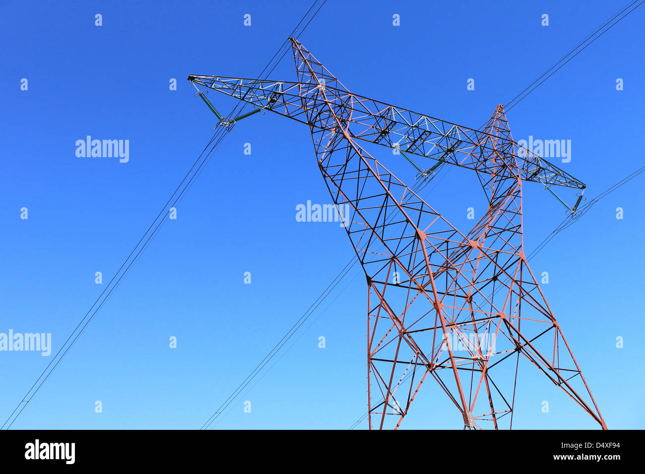 on an electricity pylon against blue sky for a renewable electricity or nuclear - Stock Image