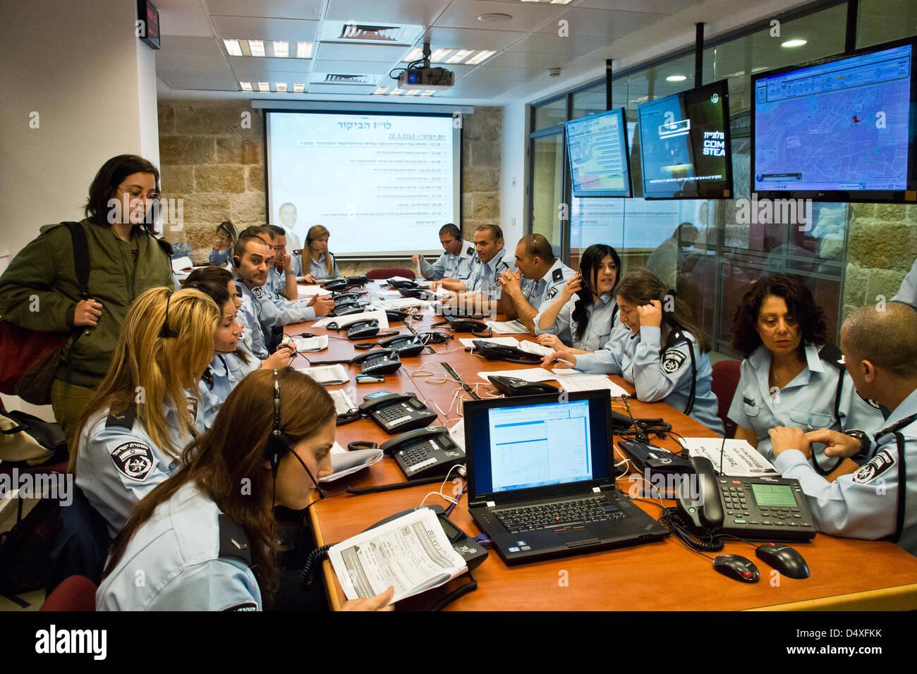 Twenty police officers staff the Jerusalem Police District Information Center set up to provide citizens with information - Stock Image