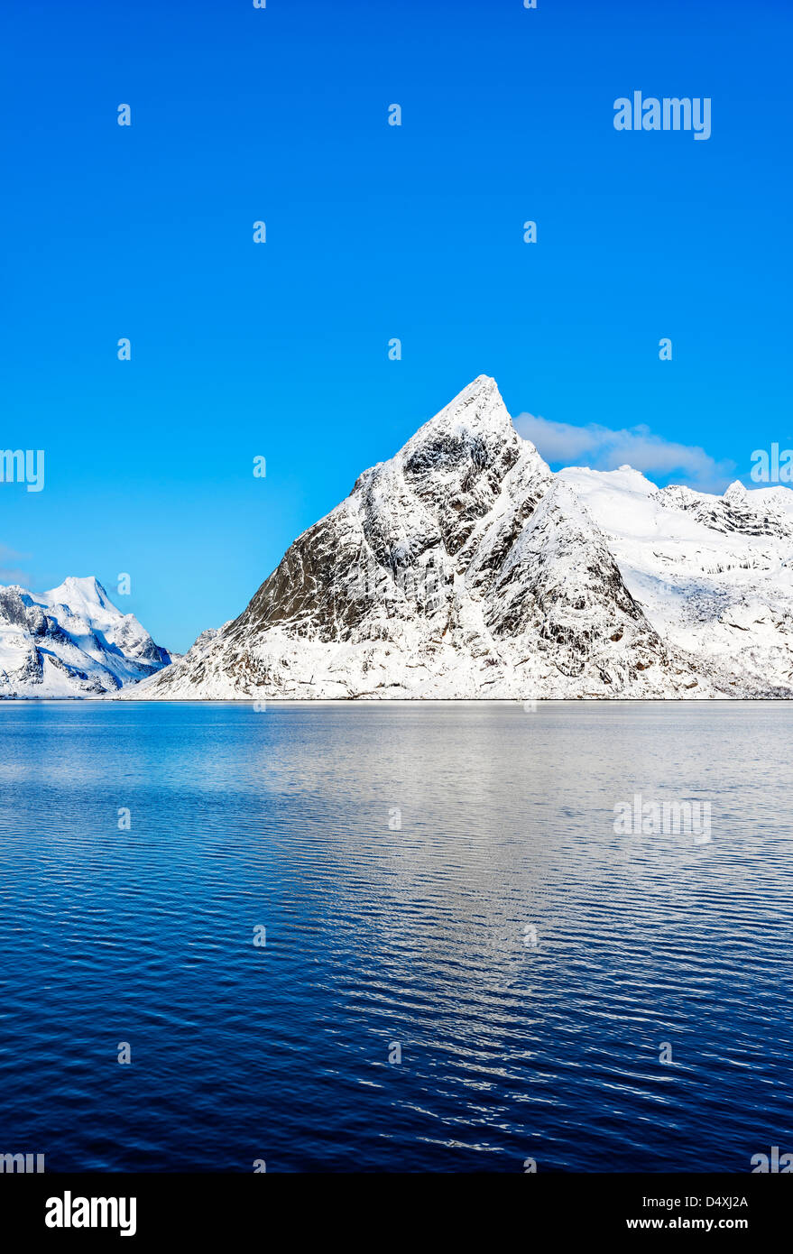 A view of mount Olstind on the Lofoten islands on a glorious sunny winter morning - Stock Image
