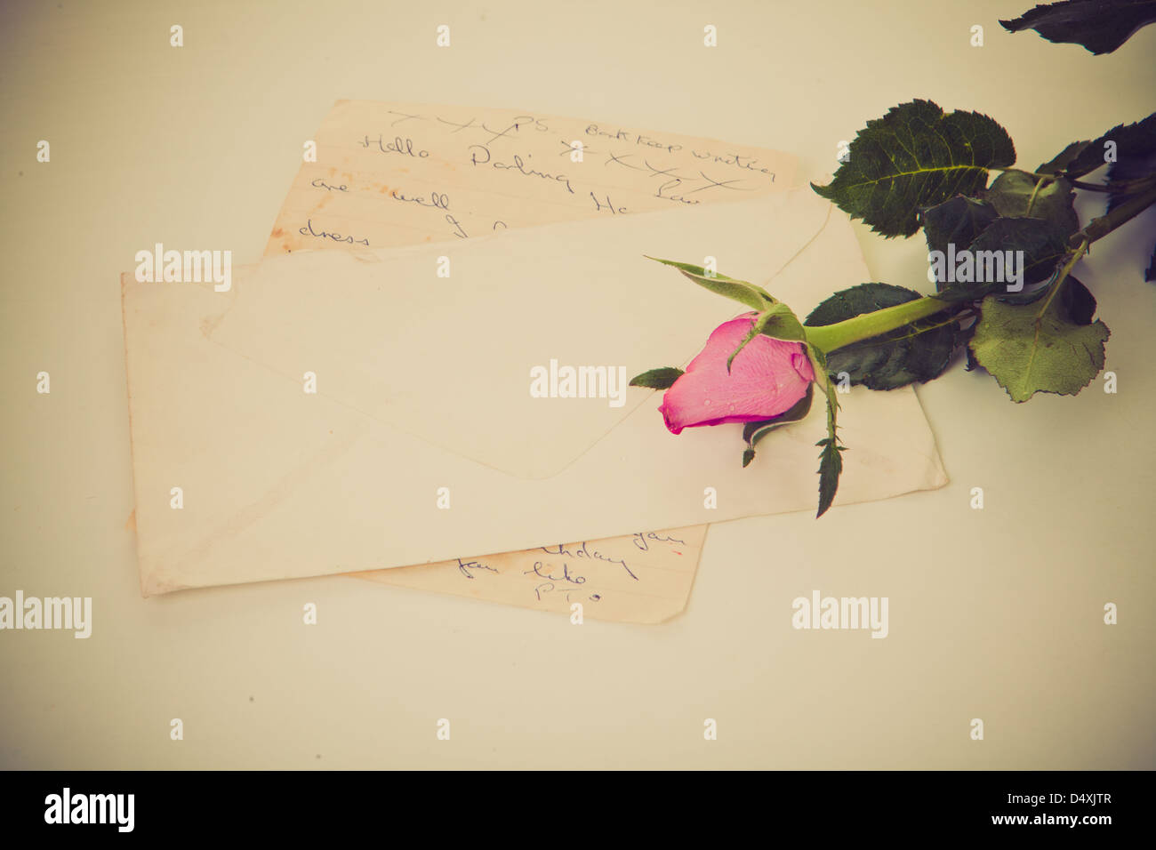 old retro vintage love letter with rose. - Stock Image