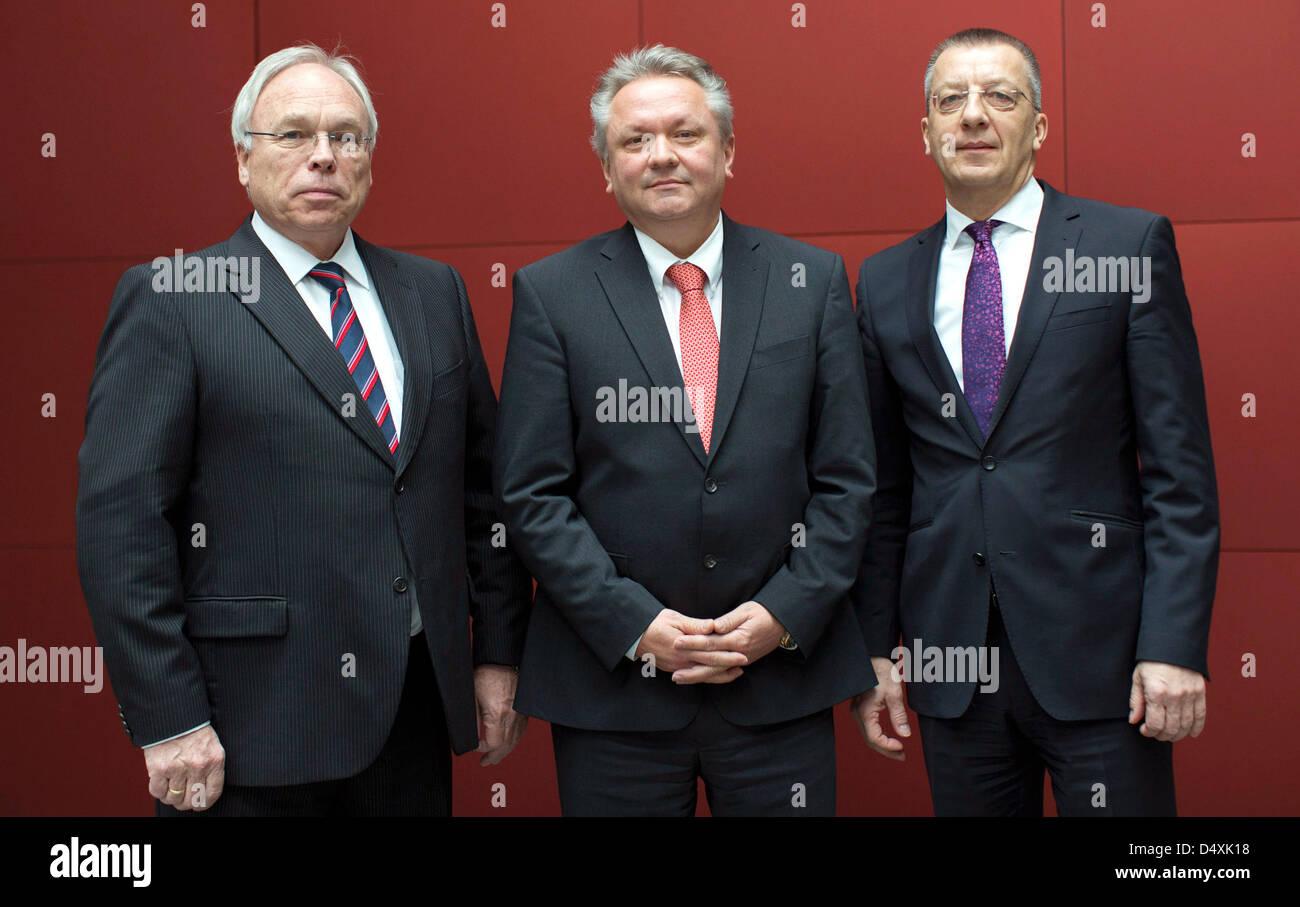 Rheinmetall AG board members Gerd Kleinert (L-R), Armin Papperger and Helmut P. Merch pose during the balance press - Stock Image