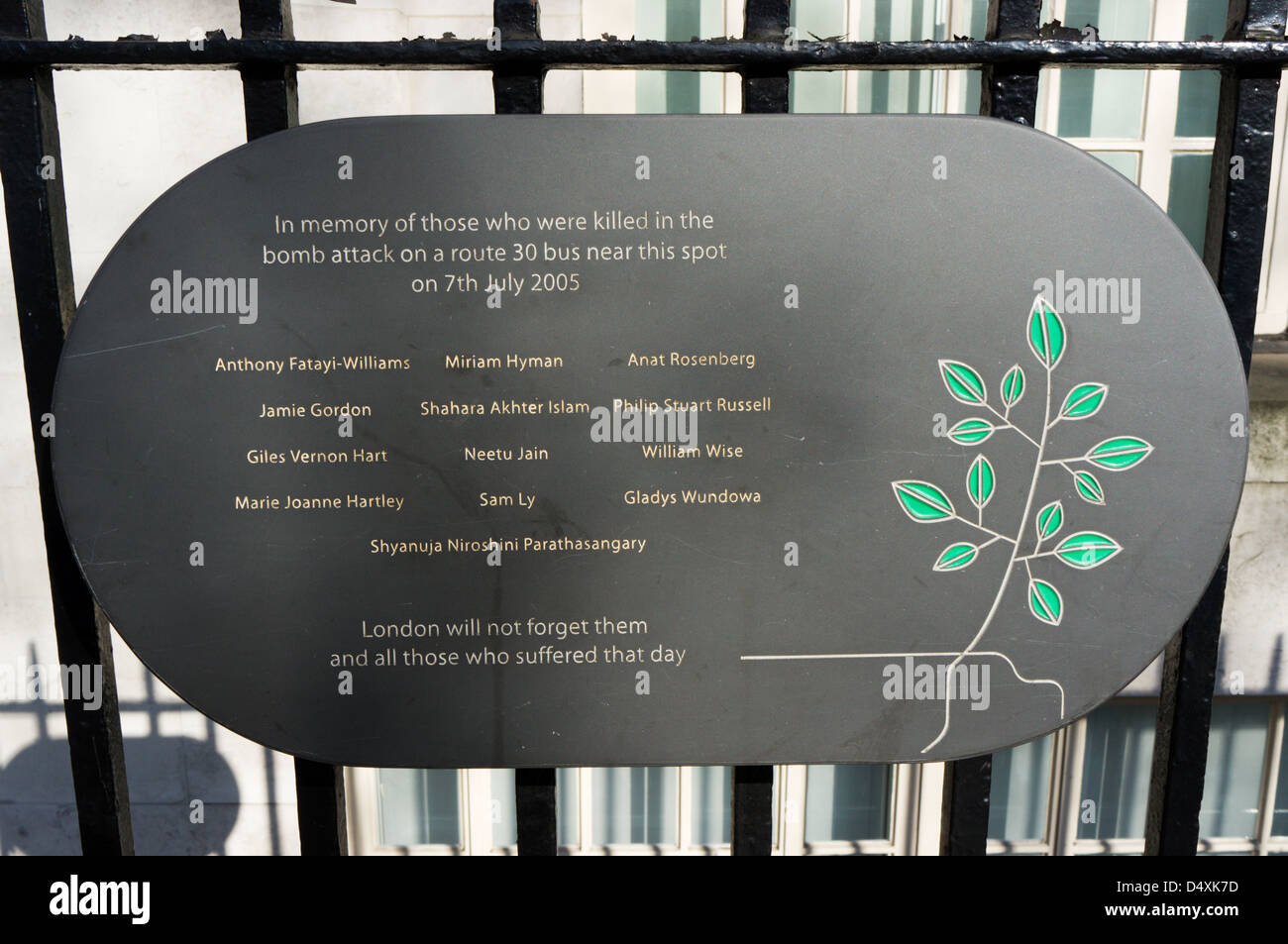 A plaque on railings in Tavistock Square in memory of those killed in the 7th July 2005 terrorist attack on a London - Stock Image