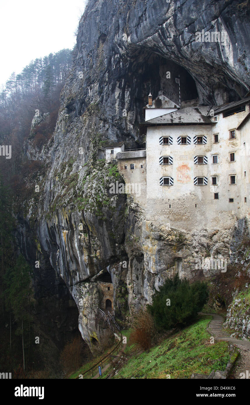 Exterior of Predjama Castle rock mountain hillside Slovenia Stock Photo
