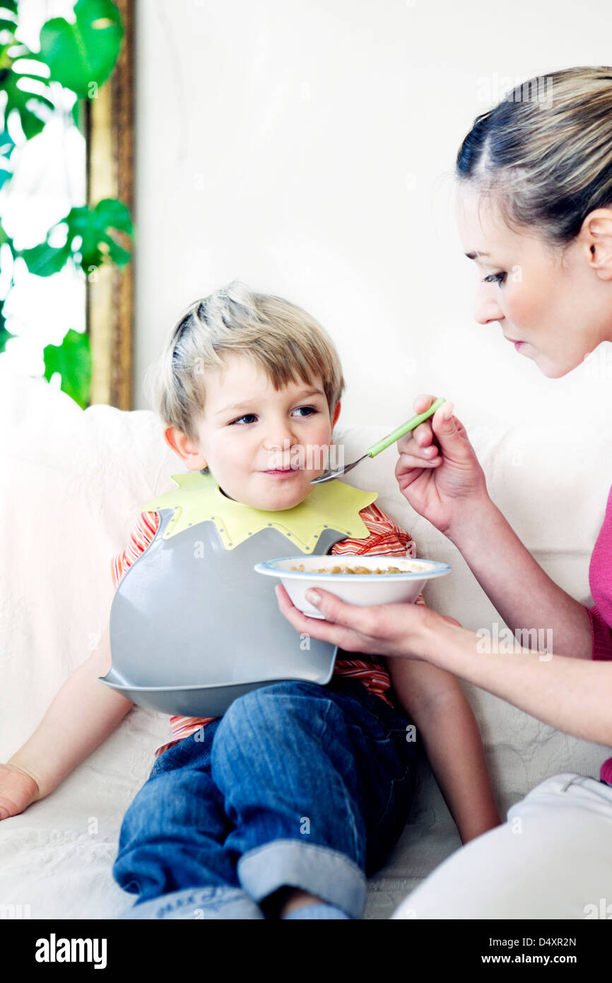 CHILD EATING A MEAL - Stock Image