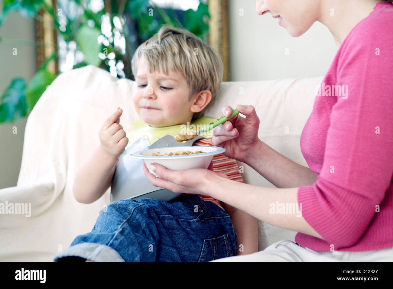 CHILD EATING A MEAL Stock Photo