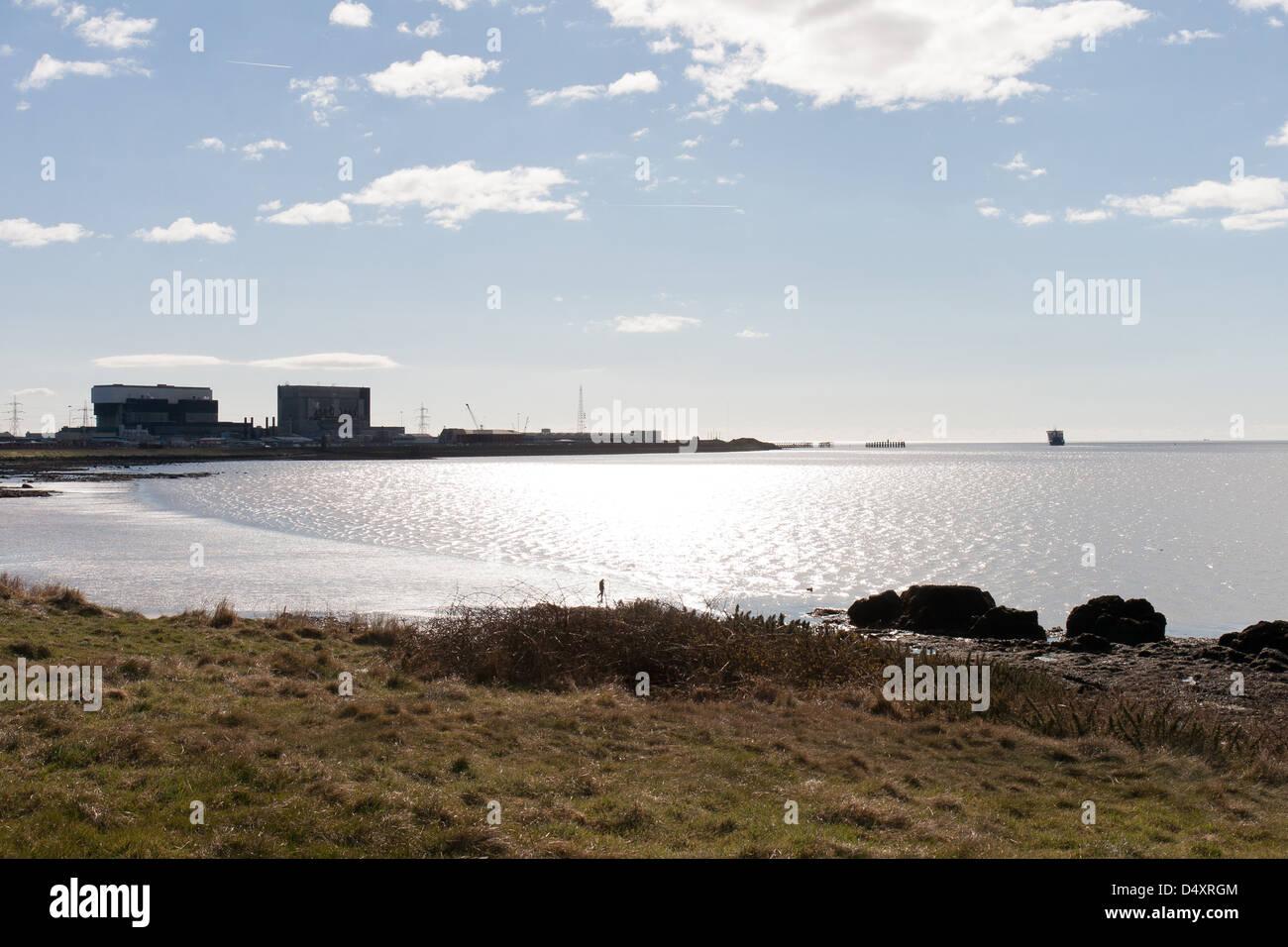 Heysham Lancashire, England with the power station silhouetted - Stock Image