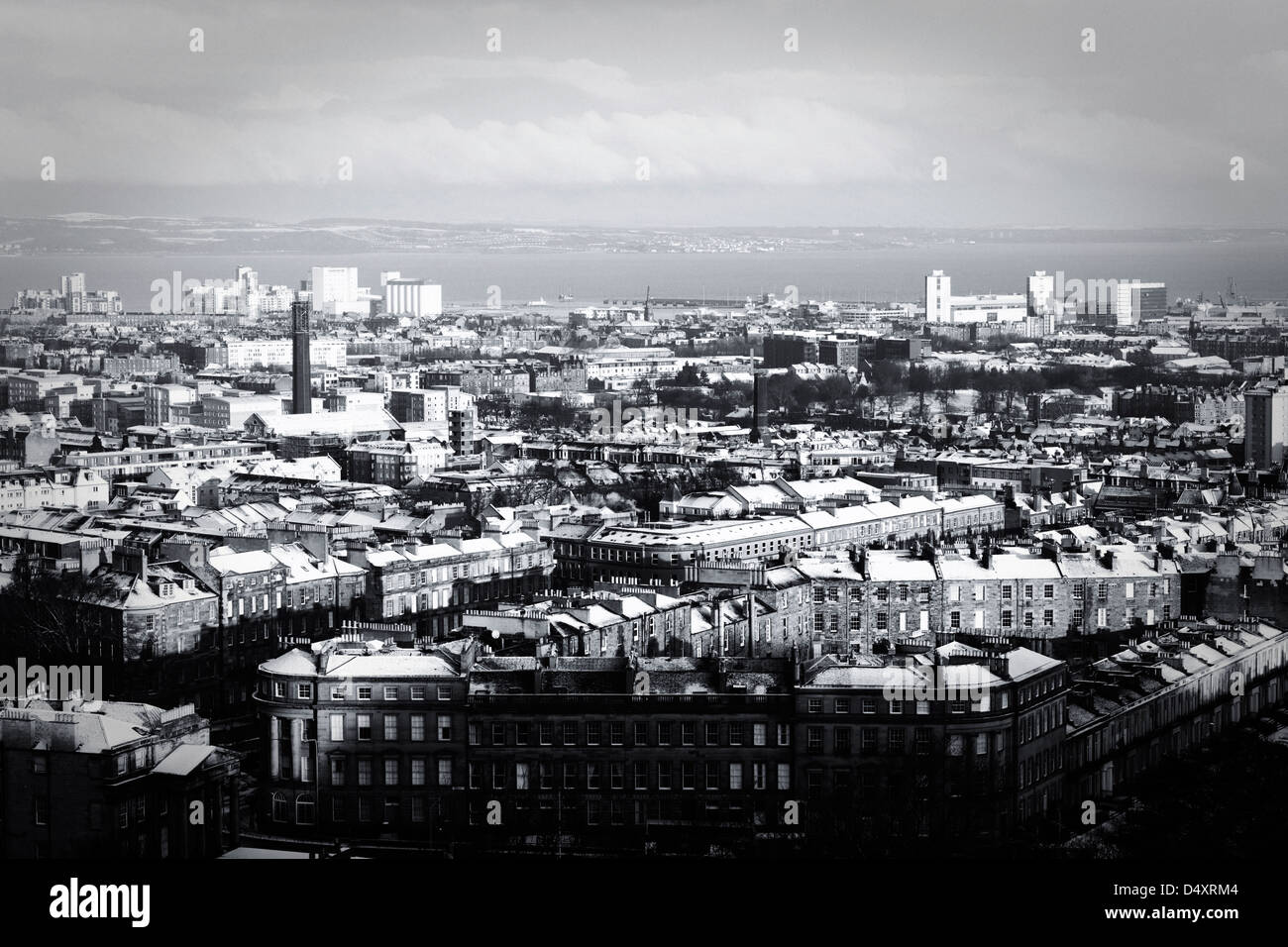 View from Carlton Hill in Edinburgh of Leith roof tops with snow on them and ground. - Stock Image