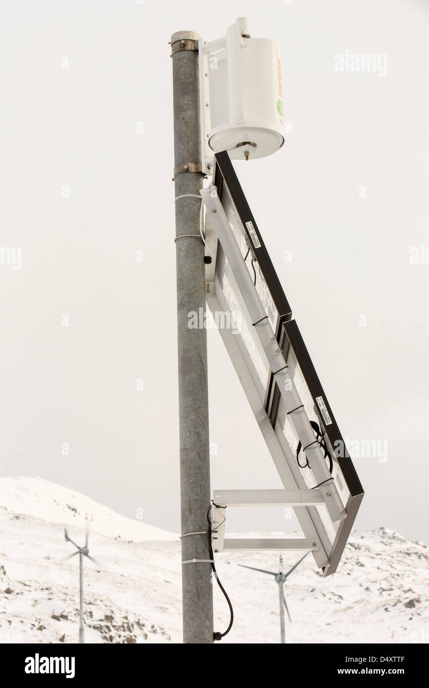 A small vertical axis wind turbine and solar panel on