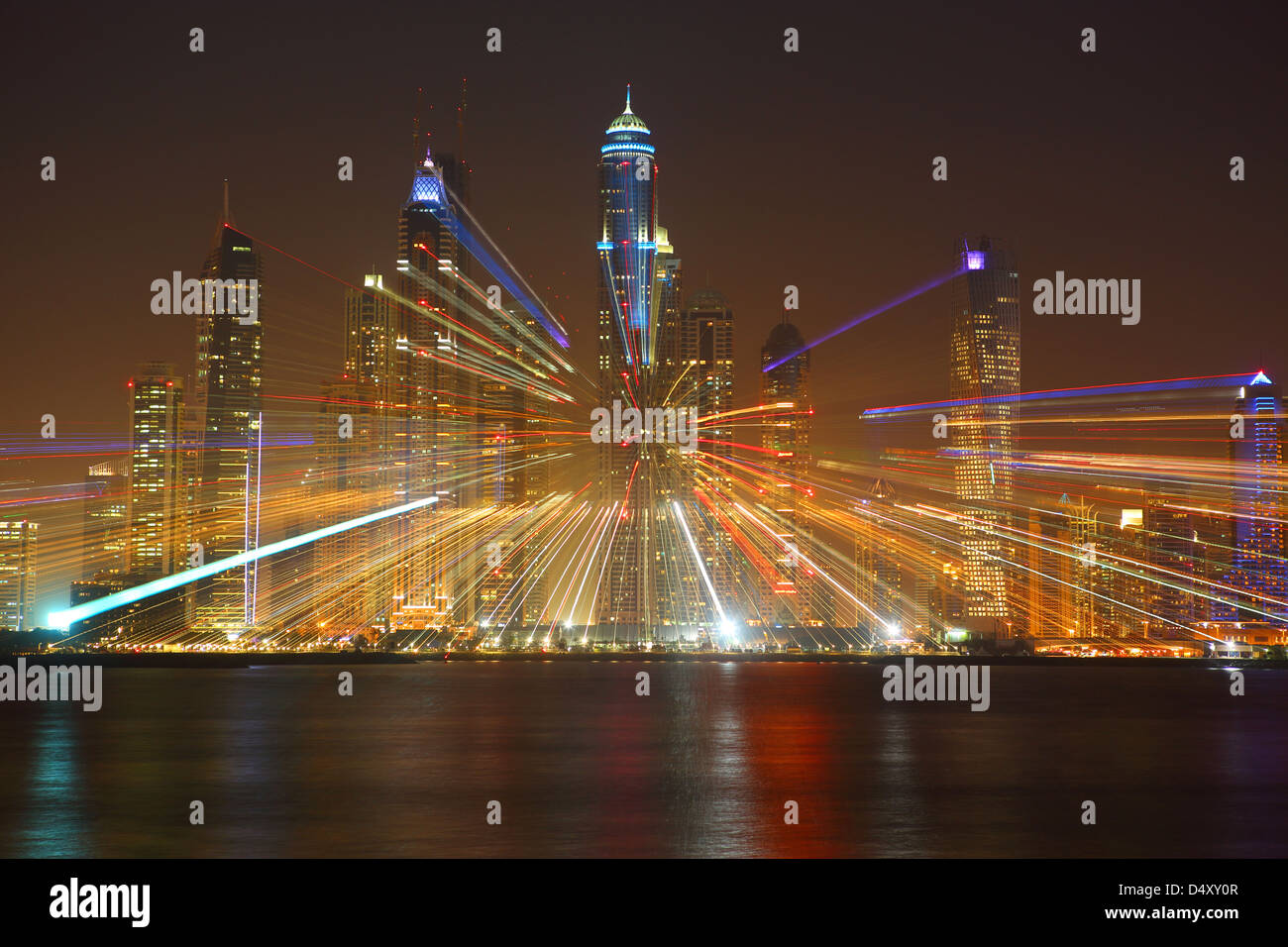 Dubai Marina skyline at night with lens zoom, United Arab Emirates - Stock Image