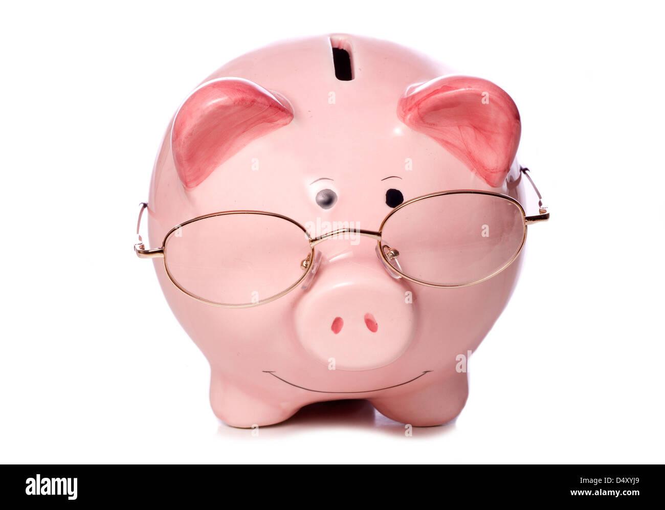 wise money saving piggy bank studio cut out - Stock Image