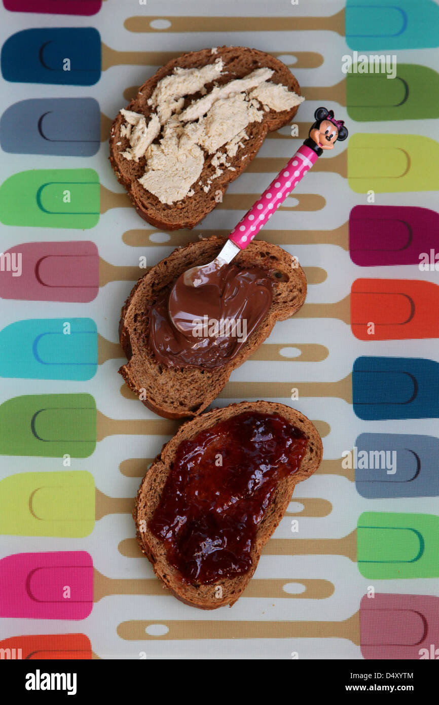 three home made sandwiches with chocolate spread, jam and Halva - Stock Image