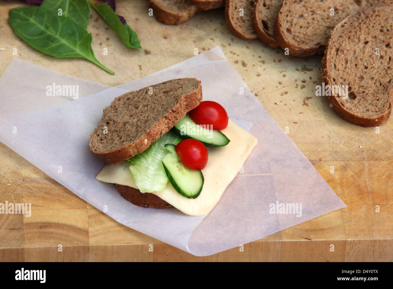 Yellow cheese sandwich with tomato and cucumber - Stock Image
