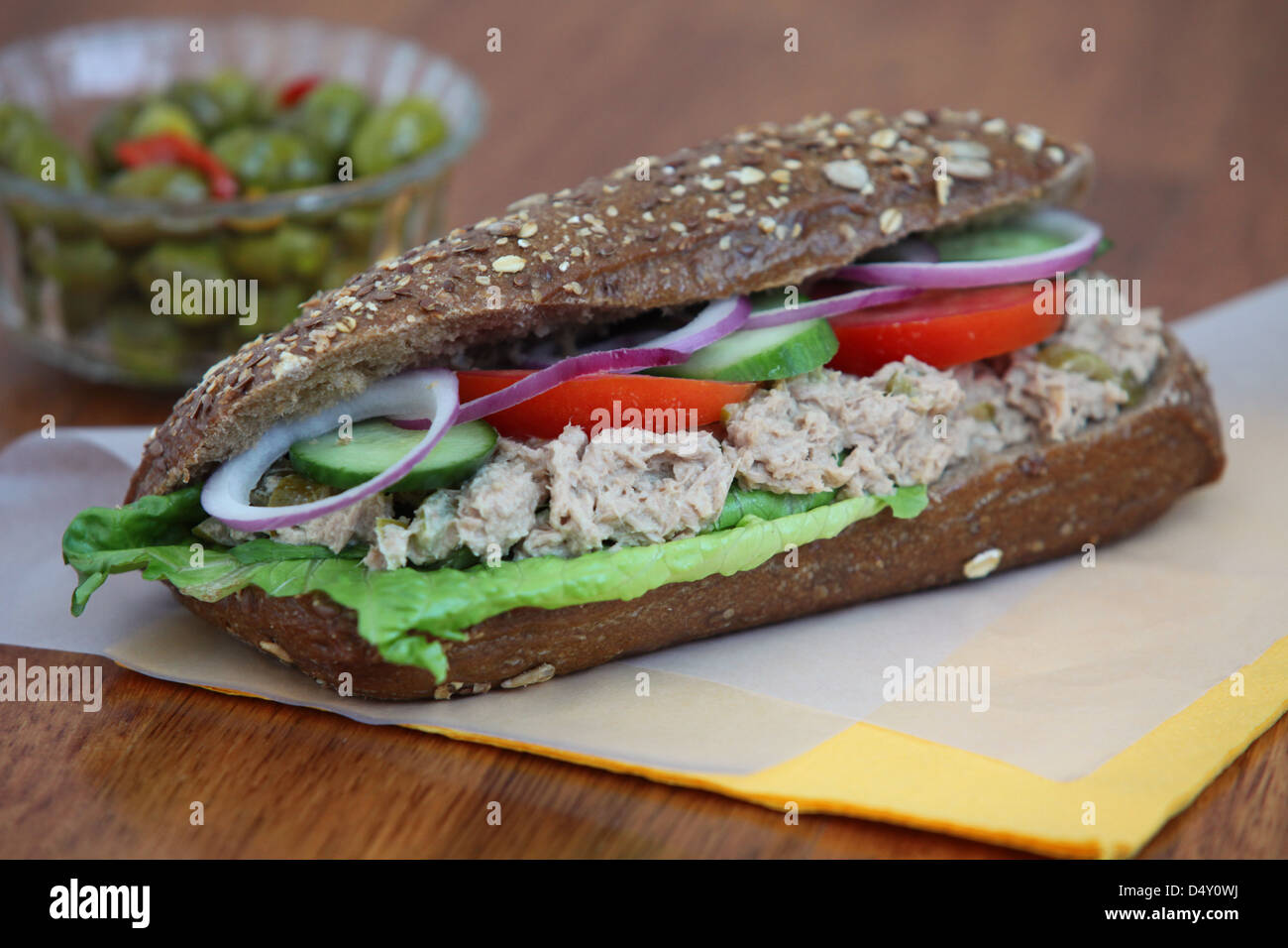 Tuna salad sandwich with tomato and cucumber - Stock Image