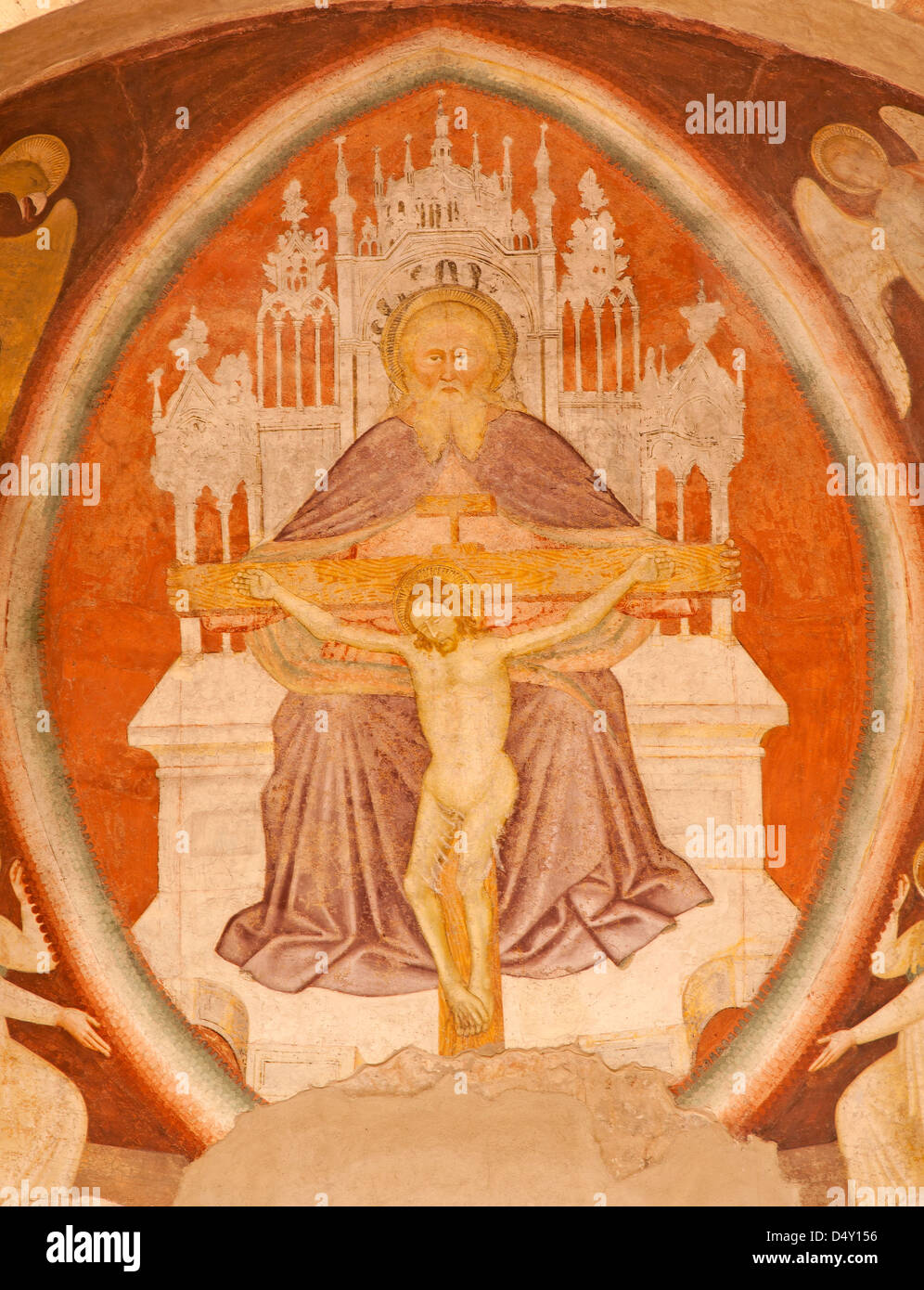 VERONA - JANUARY 28: Fresco of holy Trinity from main apse of Chiesa di Santissima Trinita consecrated in 1117 - Stock Image