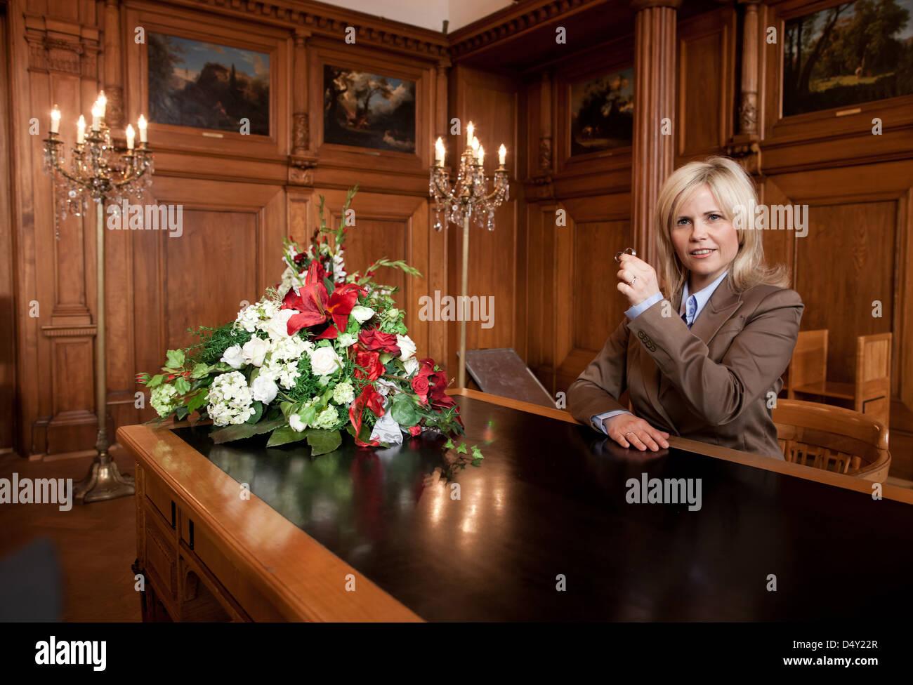 Michaela Schaffrath filming a guest appearance as a registrar on the set of ARD TV series 'Verbotene Liebe'. Bergisch Stock Photo