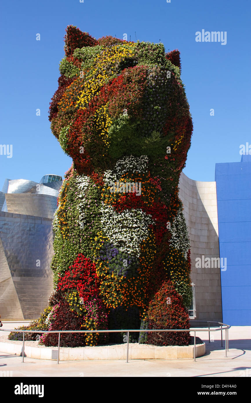 Puppy sculpture by Jeff Koons. This is a giant dog made of flowers. the Guggenheim Museum, Bilbao, Euskadi, Spain. - Stock Image