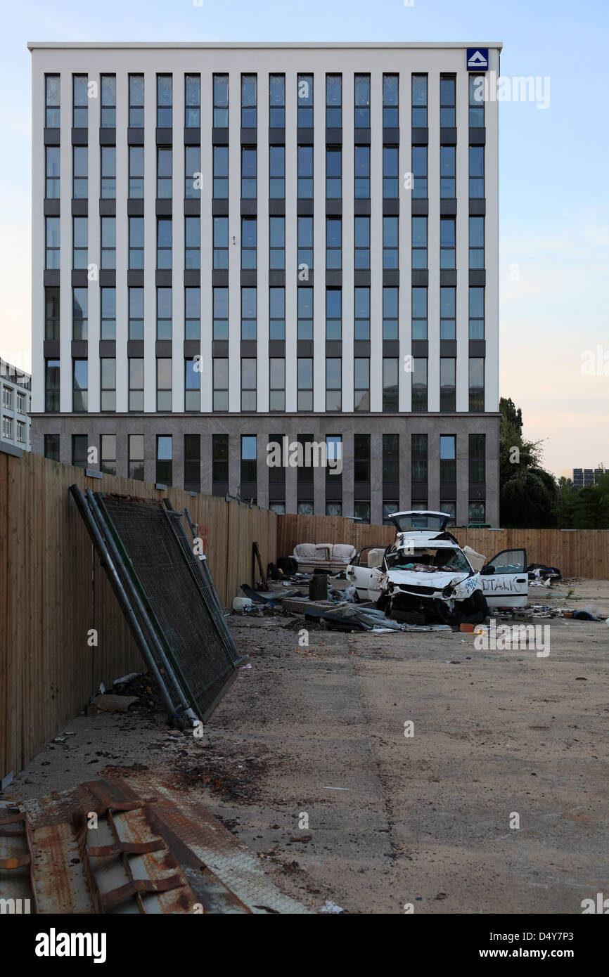 Berlin, Germany, construction of a Geschaeftsgebaeudes front of a parked car accident - Stock Image