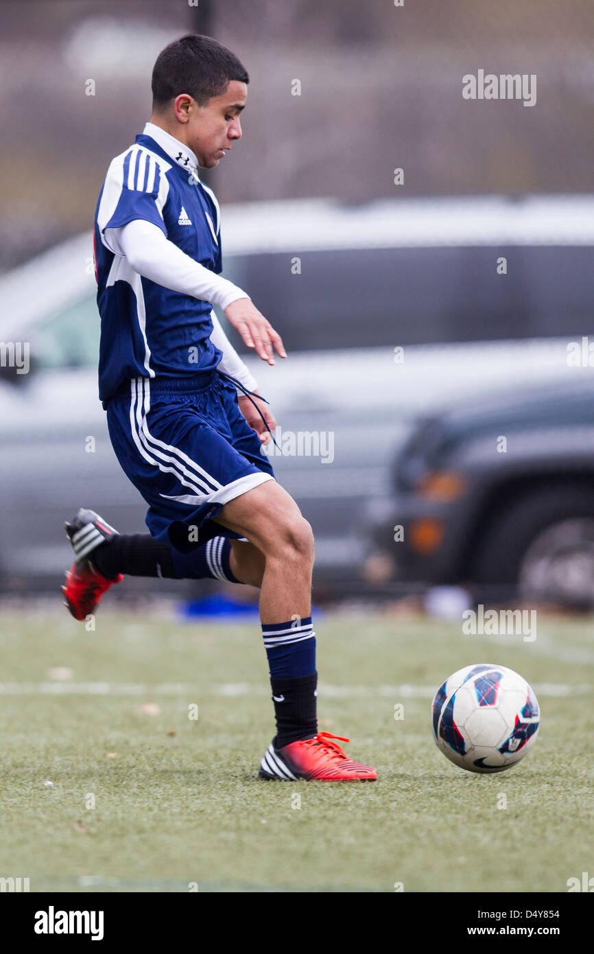 Teen boys soccer action. - Stock Image