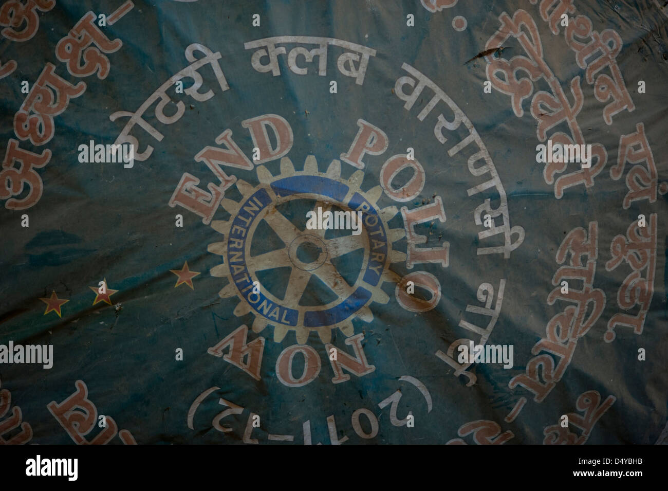 End Polio Now umbrella in Hindi and English at Varanasi India - Stock Image