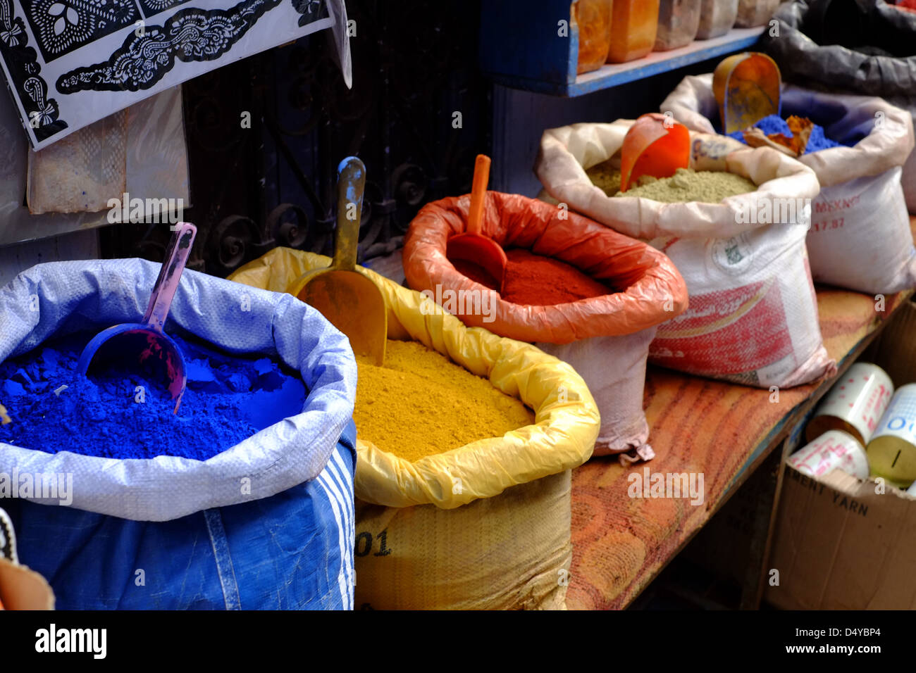 Paint dyes in sacks at a shop in the streets of Chefchaouen Morocco - Stock Image