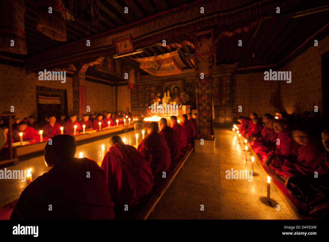 Bhutan, monks in temple. - Stock Image