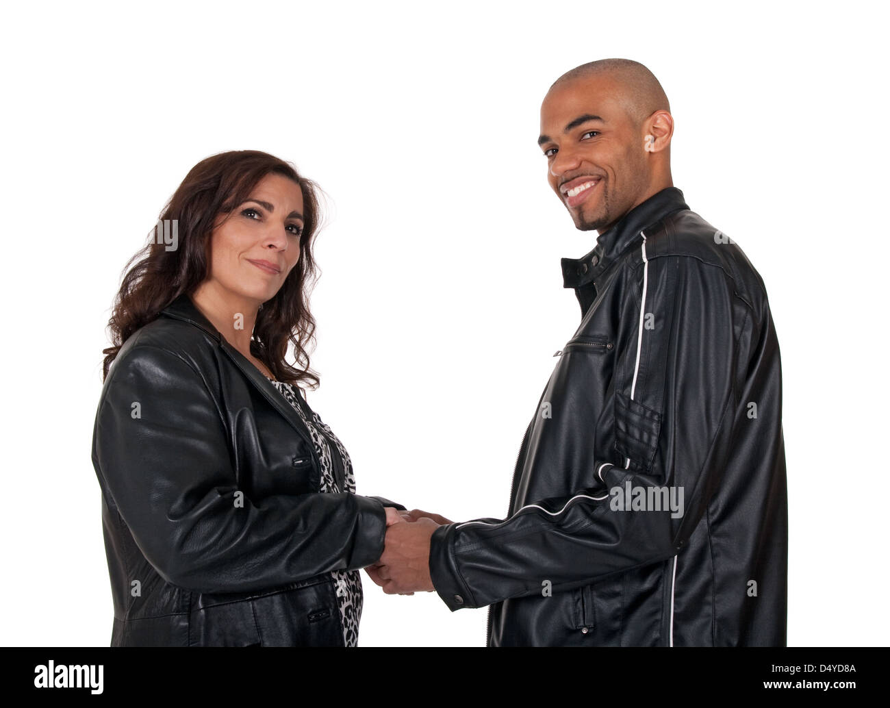 Adult multicultural couple holding hands. Mature woman with younger man. - Stock Image