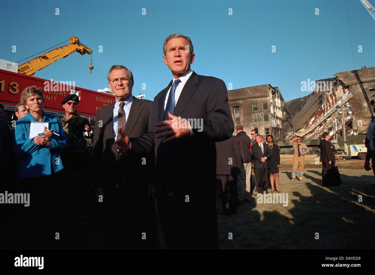 President George W. Bush delivers remarks in front of the damaged Pentagon Wednesday, Sept. 12, 2001, in Arlington, - Stock Image