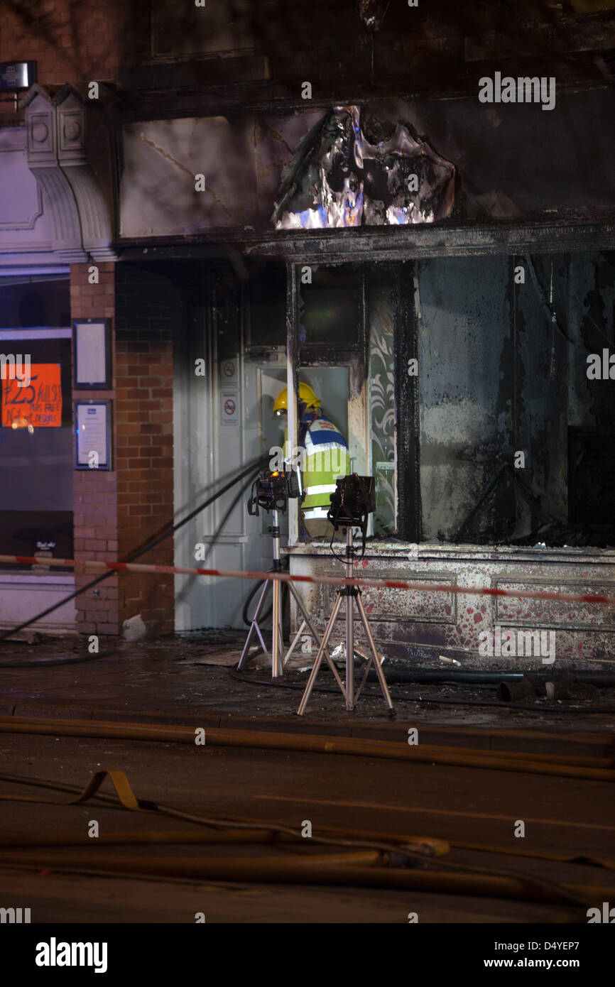 Tamworth, Staffordshire, UK. 20th March 2013. Fire rips through nightclub. Firefighter enters the building with - Stock Image