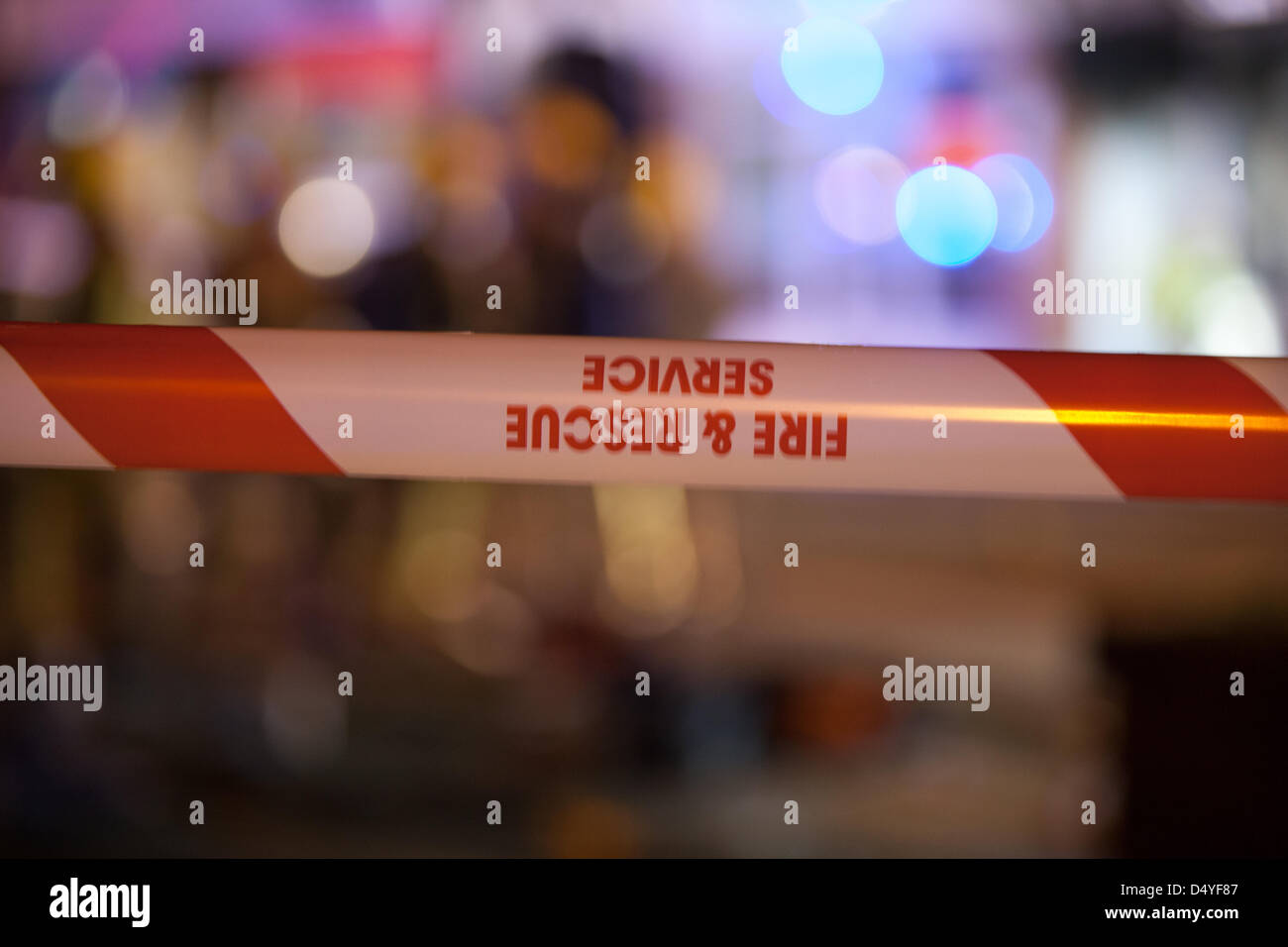 Tamworth, Staffordshire, UK. 20th March 2013. Fire rips through nightclub. Hazard tape at the scene of a fire. Credit: - Stock Image