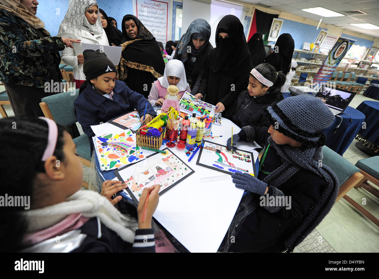 Kuwait, Kuwait City, drawing activities in classroom with supervising teachers with burqa. (MR) - Stock Image