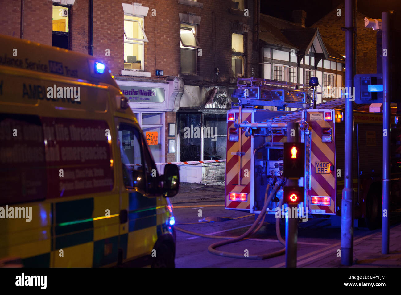 Tamworth, Staffordshire, UK. 20th March 2013. Fire rips through nightclub. Ambulance and Fire Engine with the burnt - Stock Image