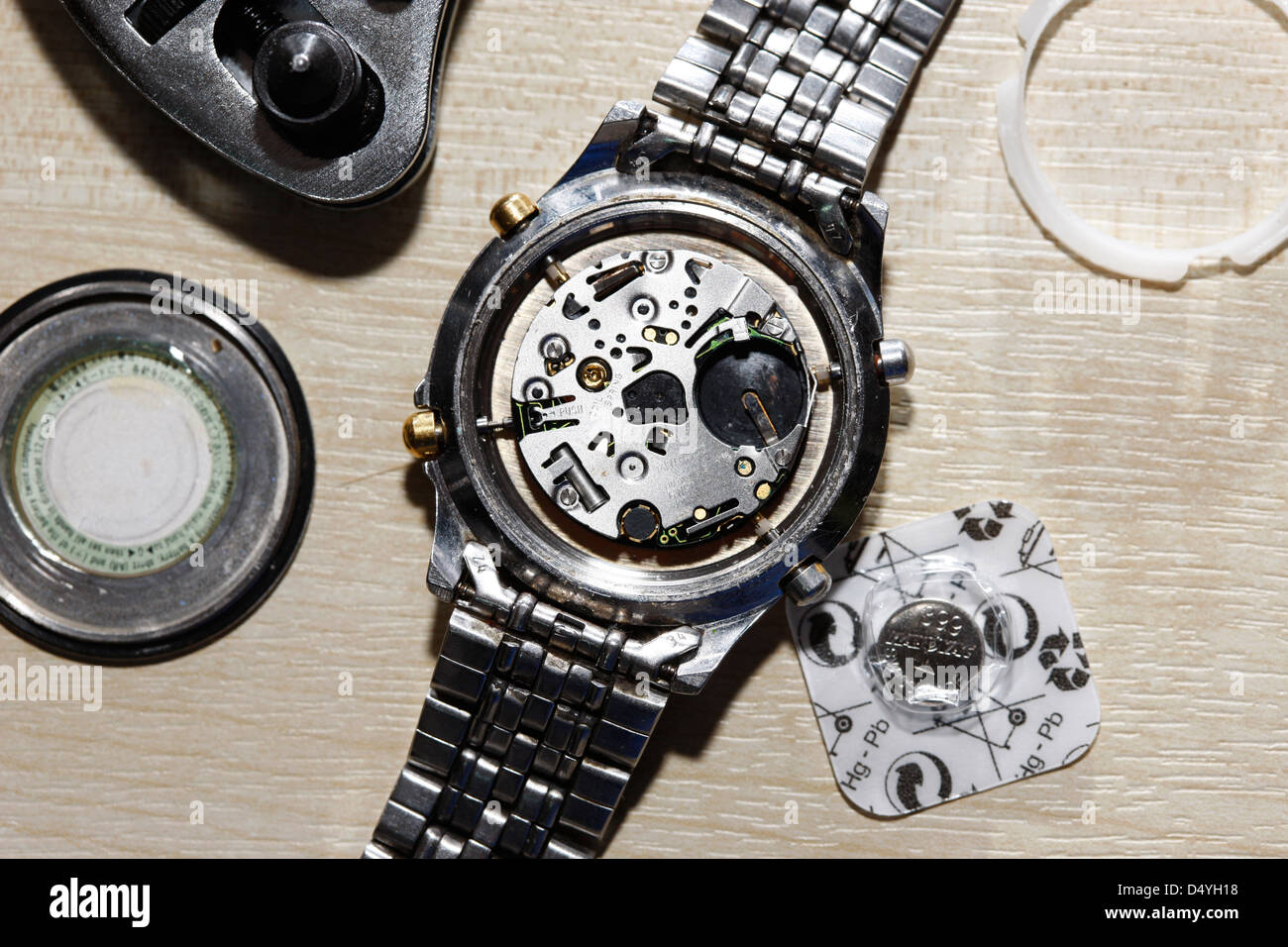 replacing the battery in a metal band wristwatch - Stock Image