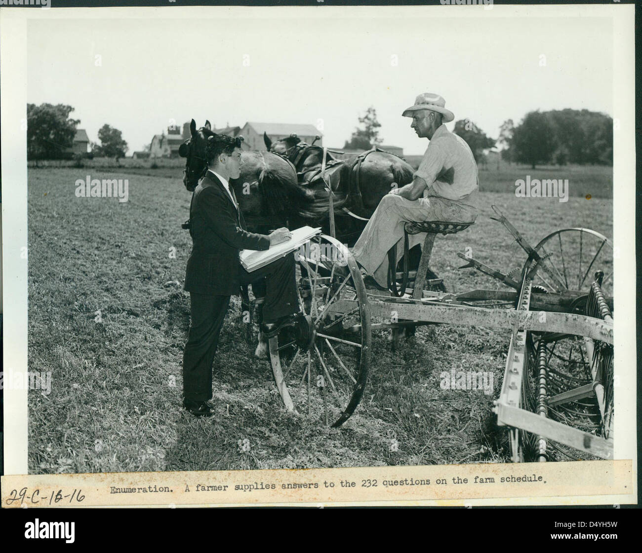 Enumeration, a Farmer Supplies Answers to the 232 Questions on the Farm Schedule, 1940 - 1941 - Stock Image